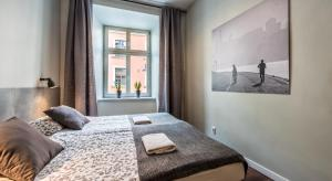 A bed or beds in a room at Flaminio Smart Sleep