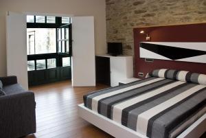 Cama o camas de una habitación en Apartamentos Domus Stellae