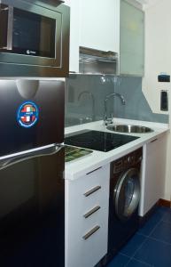 Una cocina o zona de cocina en Apartamentos Domus Stellae