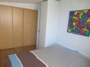 Een bed of bedden in een kamer bij Appartement Iris
