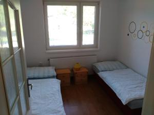 A bed or beds in a room at Penzión Anika