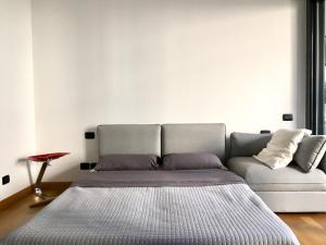 A bed or beds in a room at Loft Giulietta