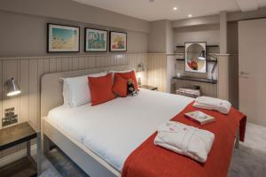 A bed or beds in a room at The Lawrance Luxury Aparthotel - York