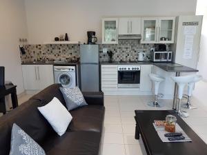 Köök või kööginurk majutusasutuses Rieks van der Walt Self-Catering Apartment