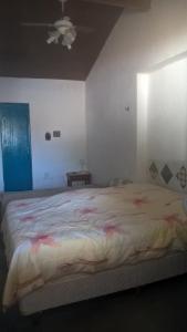 A bed or beds in a room at Fazenda Poço das Pedras
