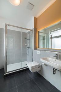 Ein Badezimmer in der Unterkunft Apartments Drei Morgen