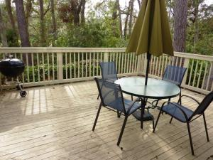 A balcony or terrace at Seapines 600 Wildwood Spa Villas