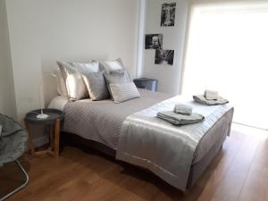 A bed or beds in a room at Vila Bracara II