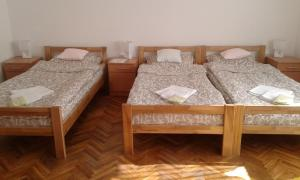 A bed or beds in a room at TNS 27 Apartment