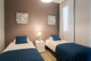 Ein Bett oder Betten in einem Zimmer der Unterkunft Barcelonaguest