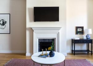 A television and/or entertainment center at Three-Bedroom on Newbury Street Apt 31