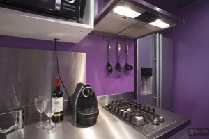 A cozinha ou cozinha compacta de Le Marais Apartments