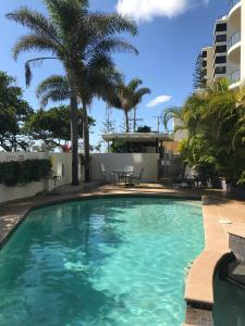 The swimming pool at or near Meridian Alex Beach Apartments