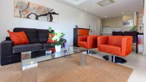 A seating area at Apartamentos Benitachell