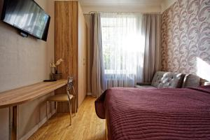 A bed or beds in a room at RIGAAPARTMENT Gertruda Apartments & Restaurant