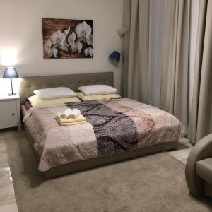 Ein Bett oder Betten in einem Zimmer der Unterkunft PRAGUE MOON SUITE HOTEL