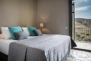 A bed or beds in a room at Myrtos View Apartments