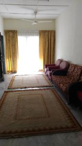 A bed or beds in a room at BaitunNajah Homestay