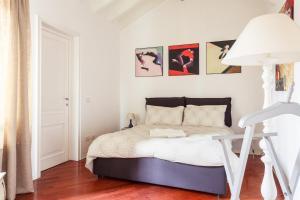 Letto o letti in una camera di Casa Emma Piazza Maggiore