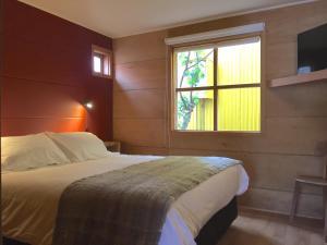 Letto o letti in una camera di Palafito Azul Apart Hotel