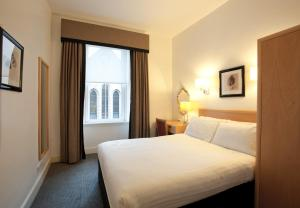 A bed or beds in a room at Skene House Hotels - Rosemount