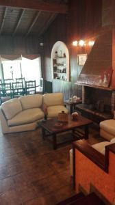 Un lugar para sentarse en Tejas Verdes Alojamiento Familiar