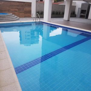 The swimming pool at or near Altos del Sur Apartments & Suites