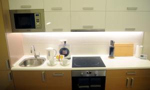 Küche/Küchenzeile in der Unterkunft Synagogue Central Apartment