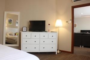 A television and/or entertainment center at Alocassia Serviced Apartments