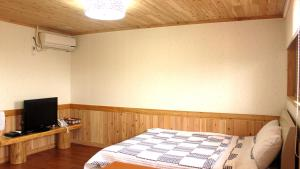 A bed or beds in a room at Nokcha Resort