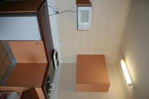 A kitchen or kitchenette at Luma Luma Holiday Apartments