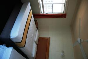 A bed or beds in a room at Luma Luma Holiday Apartments