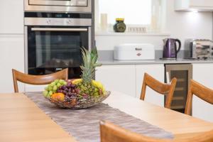 A kitchen or kitchenette at Merino Hospitality