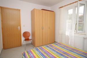 Postelja oz. postelje v sobi nastanitve Apartment Nerezine 3451d