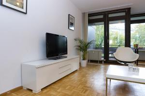 A television and/or entertainment center at Apartment Uhlandstr. 195
