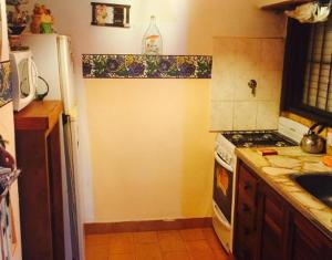 Una cocina o kitchenette en Edificio Maracuja