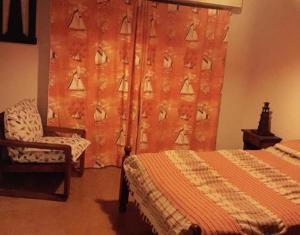 Una cama o camas en una habitación de Edificio Maracuja