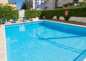 The swimming pool at or near Apartamentos Green Line Bon Sol - AB Group