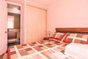 Cama o camas de una habitación en Alejandro Aliste Nº11