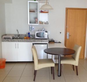 A kitchen or kitchenette at Aguas da Serra Apart