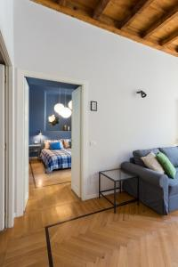 A seating area at COSY APARTMENT 2 MINUTES FROM DUOMO