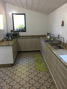 A cozinha ou cozinha compacta de Chácara Villa Casarão