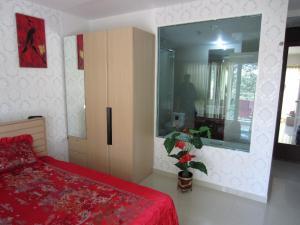 Кровать или кровати в номере AD Condo VongAmat