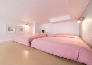 Llit o llits en una habitació de Here House Hongdae