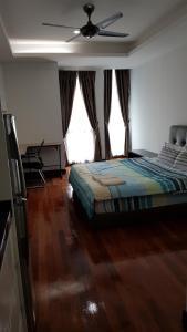 Ein Bett oder Betten in einem Zimmer der Unterkunft Casa Residency Condomonium