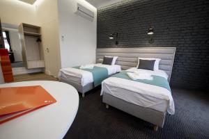Łóżko lub łóżka w pokoju w obiekcie Apartamenty Wodna 13