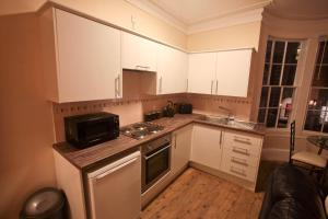 A kitchen or kitchenette at Oxford Street Apartment