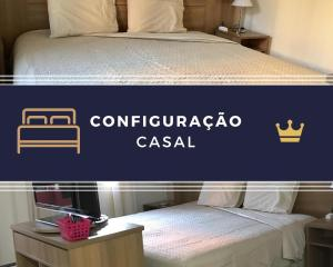 A bed or beds in a room at Flat à beira do Lago