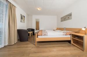 A bed or beds in a room at Chalet Aeschhorn
