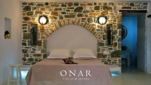 A bed or beds in a room at Onar Suites & Villas